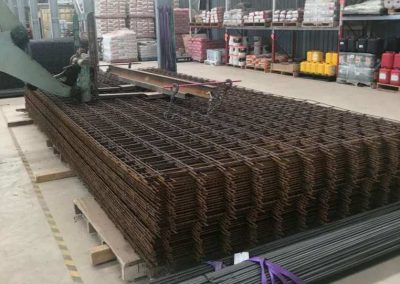 Steel reinforcing mesh order with adapted forklift being prepared for loading