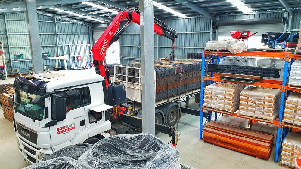 A one steel truck offloading steel reinforcing mesh