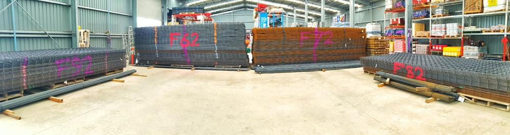 Photo shows stacks of steel reinforcing configured to make it easy for the steel reinforcing to be loaded